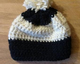 Black/cream child's winter hat