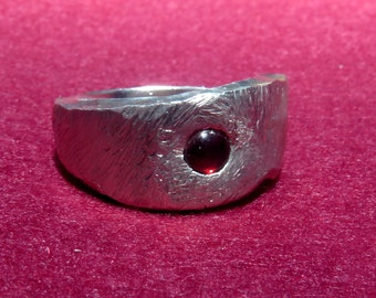 Forged silver ring with garnet stone.