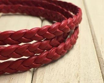 Carmine braided leather bracelet triple towers.
