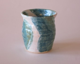 Turquoise and glossy white earthenware ceramic vase