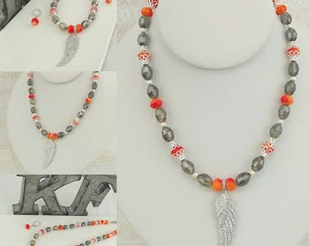 Sparkly Orange and silver wing necklace with matching earrings