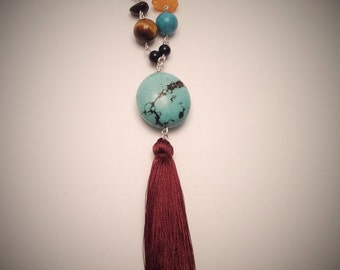 Long, turquoise necklace, Pompom.
