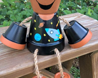 Clay pot boy with space shirt