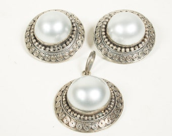 Silver jewellery set, pendant and matching clip on earrings, 925/1000, 1950s
