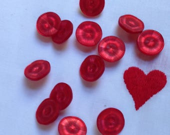 12 vintage red plastic buttons