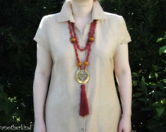 Keys to Success Bamboo Coral Necklace with Brass Medal