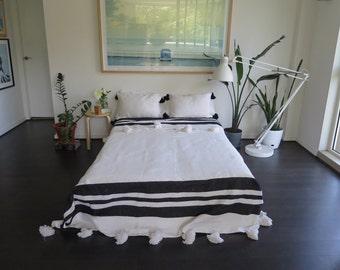 White & Black Pom Pom Moroccan Blanket