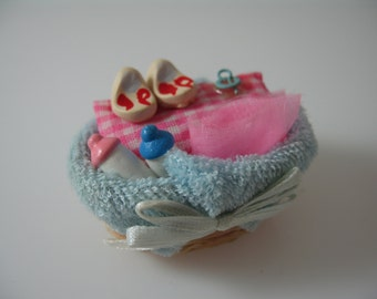 Miniature dolls house baby basket