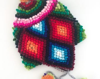 Chullo KIDS peruvian knitting traditional ethnic handmade wool hat full of amazing colors. Southamerica design Inca style, from cuzco Peru.