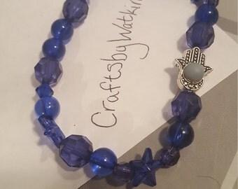 Dark blue stretchy bracelet with silver hand charm A16