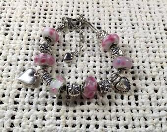 Pink glass bead silver charm bracelet