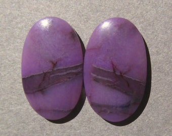Designer Gel Sugilite Matched Cabochon Pair-9 Cts. Total  18mm L X 11mm W Each