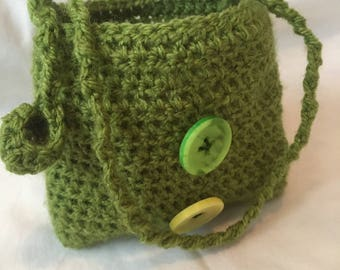You definitely need this little green crocheted pouch on your dressing table.