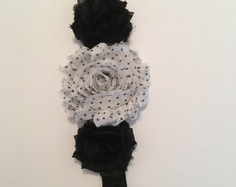 A sweet black and white headband with pearls and rhinestones.
