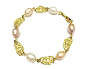 Bracelet in 18kt yellow gold with freshwater pearls