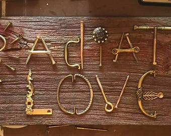 Radiate Love sign on reclaimed barn wood with old hardware letters and dresser knobs. Gorgeous expression of your favorite quote!