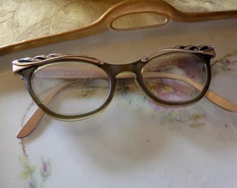 Retro cat eye horn rimmed glasses with rhinestones and a nice gold tone.