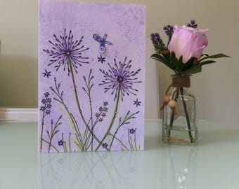 Embellished card with flowers and 3D butterflies.