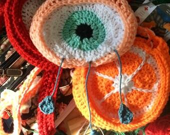 crocheted crying eye purse