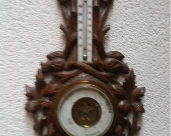 Antique barometer, made of carved wood, 1888 century.