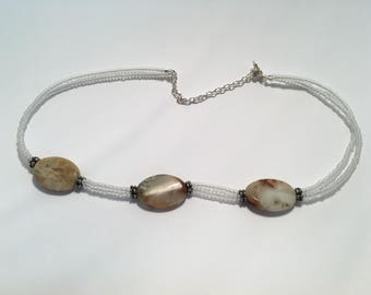 White with marbled natural stone and silver clasp