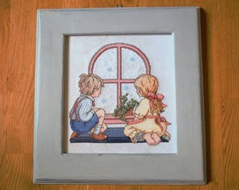 Picture cross stitching. Children at the window.