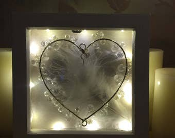 Heart and feather frame.