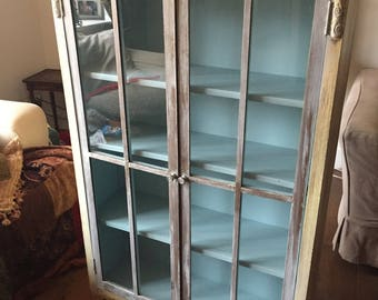 Pretty Vintage shabby chic painted display cabinet glas fronted book case.