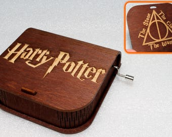 "Harry Potter - Engraved Wooden Music Box - ""Harry's Wondrous World"" - Deathly Hallows The Stone The Cloak The Wand - Hand Crank Movement"