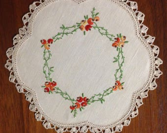 Vintage hand embroidered 23 cm scalloped round doily, boronia, autumn shades