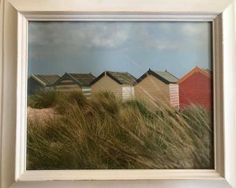 Distressed white frame with beach bungalows