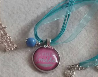 Cute kids neclace with a bright blue and hot pink look.