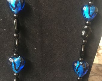 Blue and black beaded necklace and earrings set
