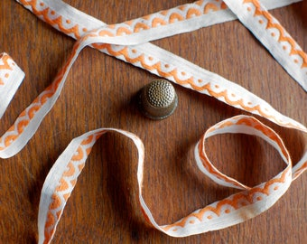 Vintage cotton edge ribbon with embroidered dots and scallops in orange over white 12mm width - 2 metres
