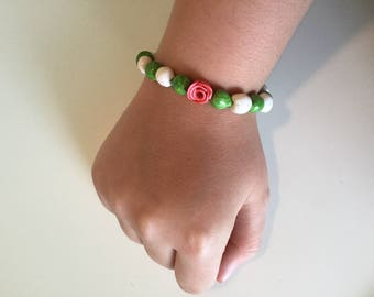 Hand made polymer bracelet with rose accent beads
