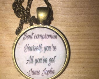 Antique gold pendant featuring a quote by Janis Joplin
