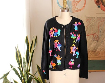 1990s novelty cardigan - cafe scenes . 90s black cardigan with figural applique people by Emma Tricot . size xs small