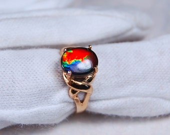 Breathtaking Grade AA 4 colour ammolite ring in yellow gold.Rare deep rich colour palette.