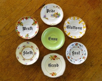 Seven Deadly Sins art assemblage hand painted vintage china saucers x 7 with hangers green with envy sinfful display decor