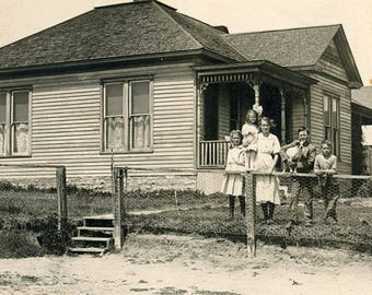 vintage photo 1920 Children Dog Perch on Fence House in Background RPPC