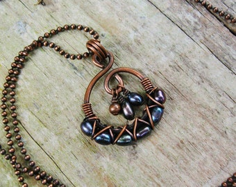 Wire Wrapped Freshwater Pearls pendant necklace - with with dark iris pearls criss cross wrapped in antiqued copper