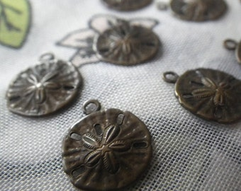 ON SALE 18% off Small Sand Dollar Brass Ox Stampings Charms Pendants 11mm Diameter 6 Pcs