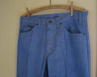 517 Levis Flared Jeans Vintage Levis Boot cut StaPrest stitched detail Chambray Blue Levis 70s Flare Vintage denim jeans zipper front 32 29
