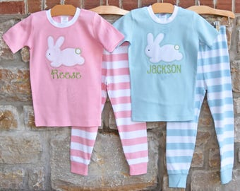 Spring for cozy-soft pj's in springtime colors. Your child's name (maximum 10 characters) is embroidered on the top; the striped bottoms have a covered elastic waist. Stretchy ribbing finishes the collar and cuffs (note the crewneck on blue pj's is slightly thicker).