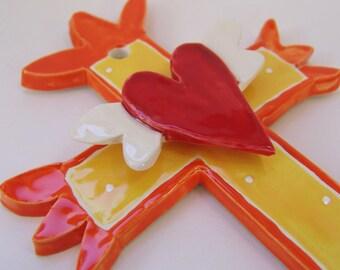 Sunny yellow & bright orange ceramic Cross with a winged heart, hand-made folk art cross