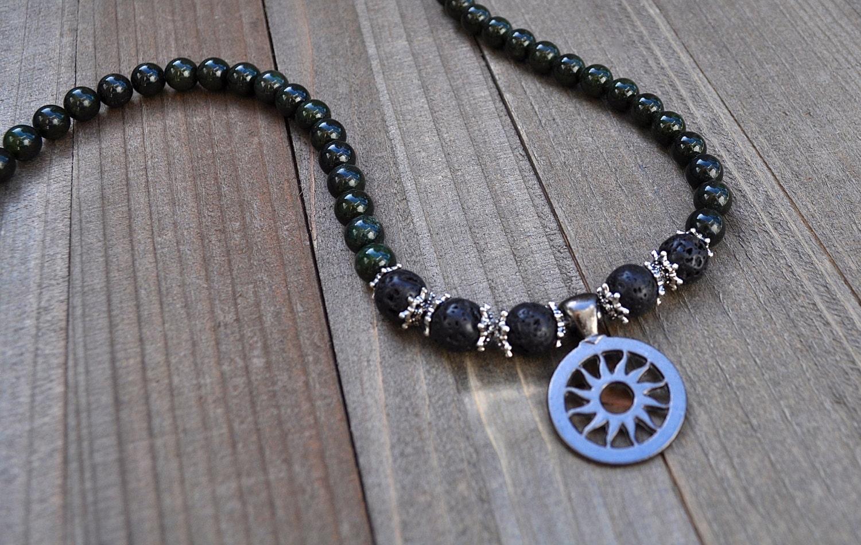 sun god necklace gunmetal grey carved metal sun black lava