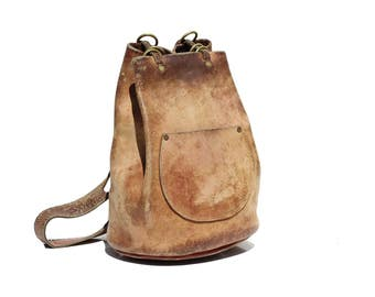 Vintage Tan thick Leather Sling Backpack