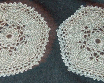 "Two small round Doilies, Pale Green, 4 1/2"" across"