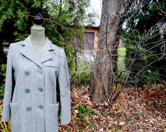 Classy vintage 70s grey wool ,military style , double breasted coat. Made by Aquamates. Size Medium.