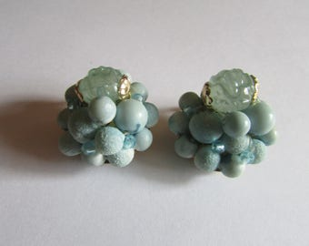 bumpy teal button clips